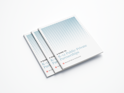 """Three booklets stacked on top of each other, titled """"A Guide to K-12 Public-Private Partnerships"""""""